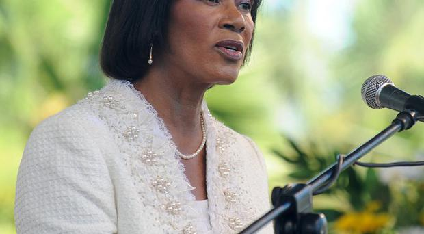 Jamaica's government, headed by prime minister Portia Simpson Miller, is to hold talks with the IMF (AP/Collin Reid)