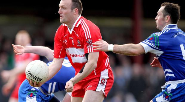 The ever-increasing use of the hand pass, as demonstrated here by Derry's Paddy Bradley, is one of the major issues in GAA at the moment