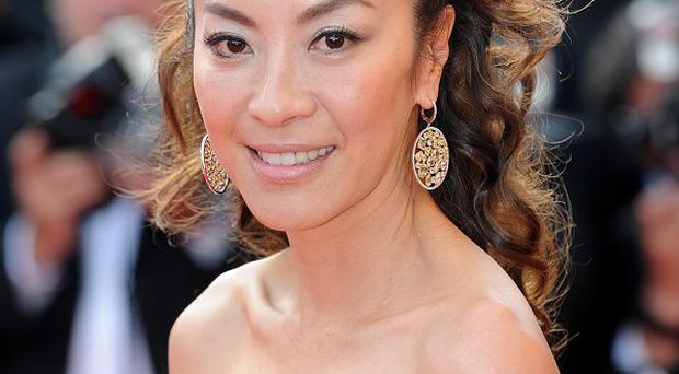 Michelle Yeoh revealed she is drawn to playing strong characters with fighting spirit