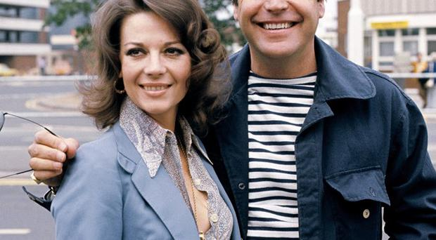Husband-and-wife Robert Wagner and Natalie Wood at Heathrow Airport in 1976