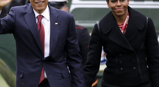Ffirst lady Michelle Obama has denied being a behind-the-scenes force in the White House whose opinions on policy and politics drew her into conflict with presidential advisers (AP)