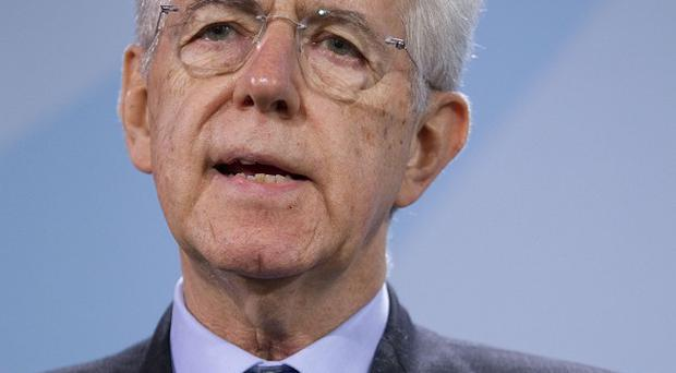 Italian Prime Minister Mario Monti wants a financial transaction tax to apply to all countries in the EU (AP)