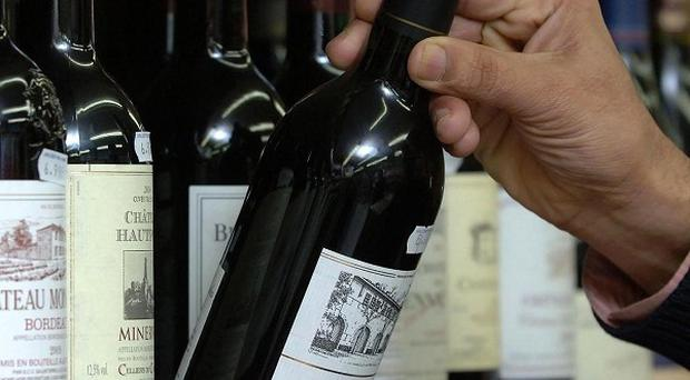 A US researcher known for his work on red wine's benefits to cardiovascular health falsified data, a university has said