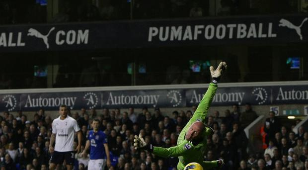 LONDON, ENGLAND - JANUARY 11: Brad Friedel of Spurs pushes the ball wide during the Barclays Premier League match between Tottenham Hotspur and Everton at White Hart Lane on January 11, 2012 in London, England. (Photo by Dean Mouhtaropoulos/Getty Images)