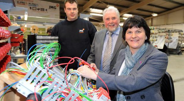Enterprise Minister Foster with Joseph McGoldrick, managing director of JMG Systems Ltd, and engineer Niall Moss (left) at the firm's plant in Omagh