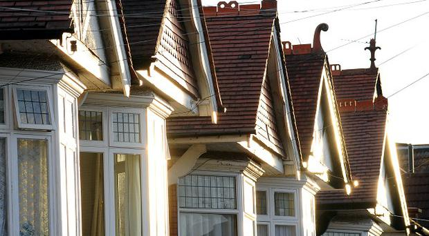 A new survey has predicted that house prices in Northern Ireland will continue to drop until March