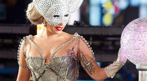 Lady Gaga admits to buying the odd designer fake when she's travelling around the world