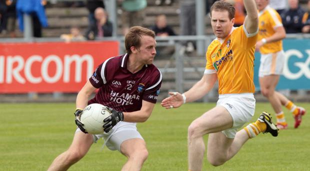 Kevin Brady (right) is crucial to Antrim's hopes of success in the McKenna Cup and beyond