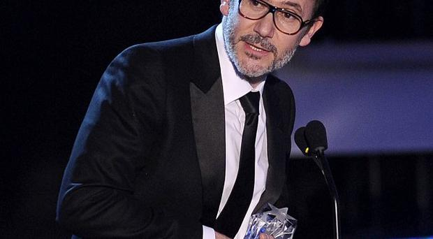Michel Hazanavicius accepts the best director award for The Artist at the Annual Critics' Choice Movie Awards in Los Angeles (AP/Chris Pizzello)