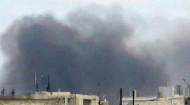 Amateur image showing smoke billowing after explosions in Homs, Syria (AP Photo/Shaam News Network via APTN)