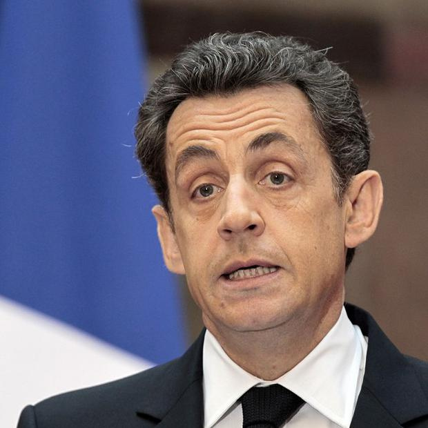 The cut in France's creditworthiness could hurt President Nicolas Sarkozy's re-election chances
