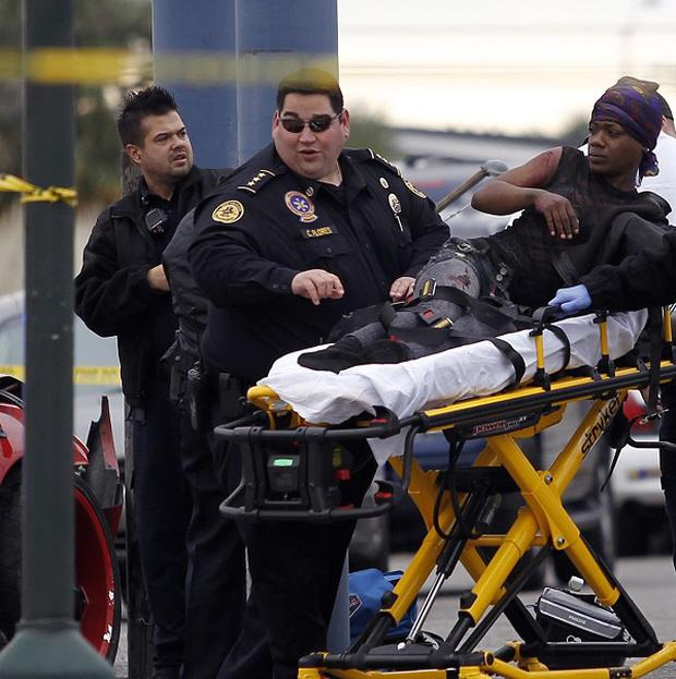 An injured person is taken to an ambulance in New Orleans after one of several shootings in the US city (AP)