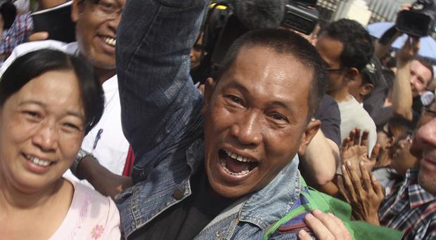 There were celebrations outside prisons in Burma as more than 650 political prisoners were freed (AP)