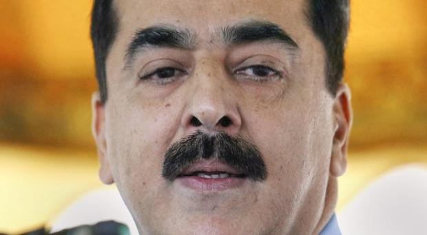 Pakistan's prime minister Yousuf Raza Gilani has asked the parliament to support him in a stand-off between the government and the army (AP)