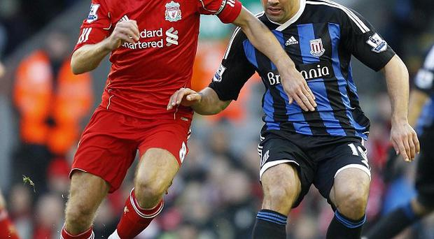 Steven Gerrard and Jonathan Walters (right)
