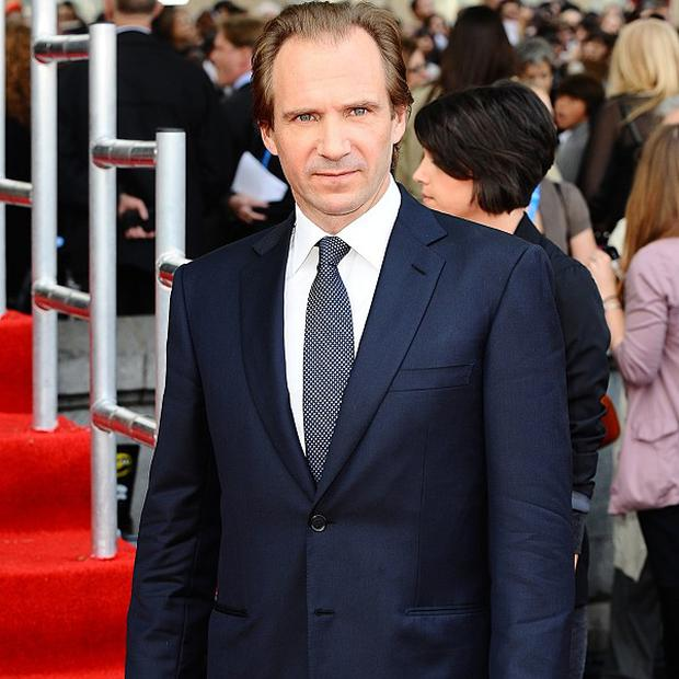 Ralph Fiennes says rumours that he is pals with Jay-Z are untrue