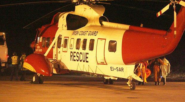 Coast Guard helicopters from Shannon and Waterford were scrambled after a trawler sank off Cork