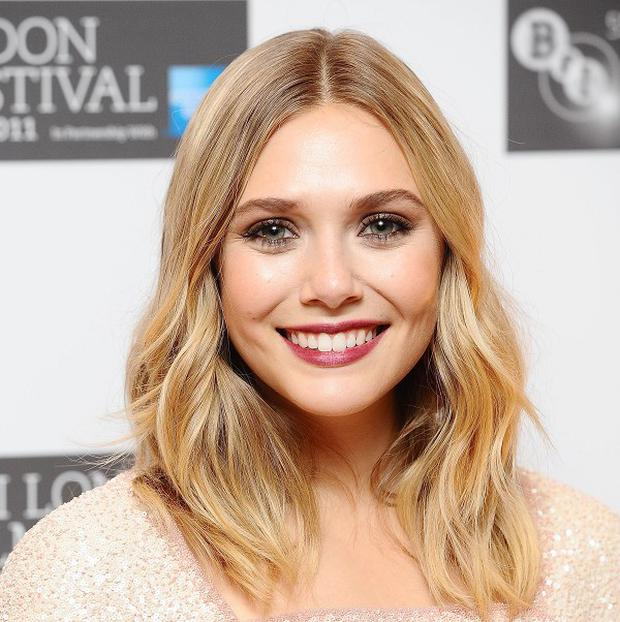 Elizabeth Olsen will star alongside Daniel Radcliffe