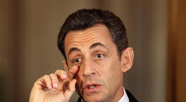 French president Nicolas Sarkozy has called for courage, calm and unity to overcome the financial crisis