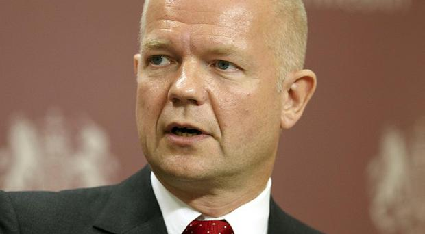 Britain is not ruling out military action against Iran, Foreign Secretary William Hague has said
