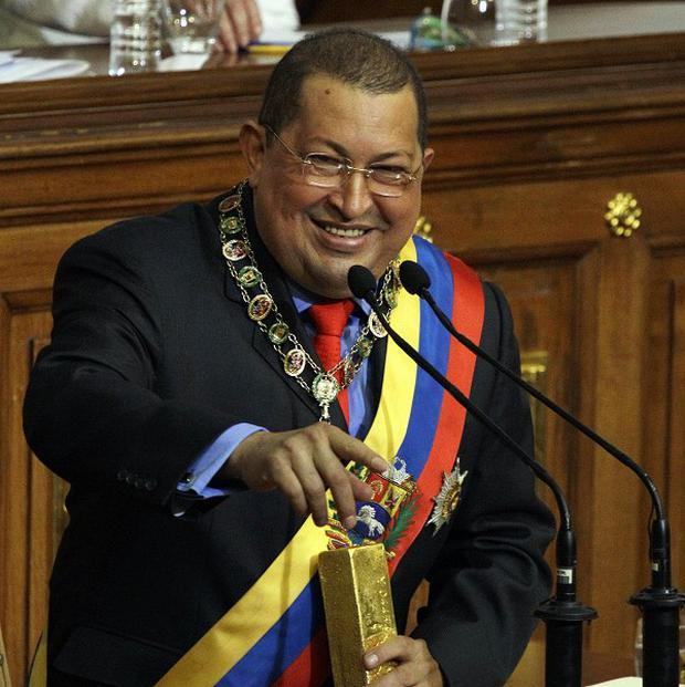Venezuela's president Hugo Chavez has seized assets of foreign companies as part of nationalisations and state takeovers (AP)