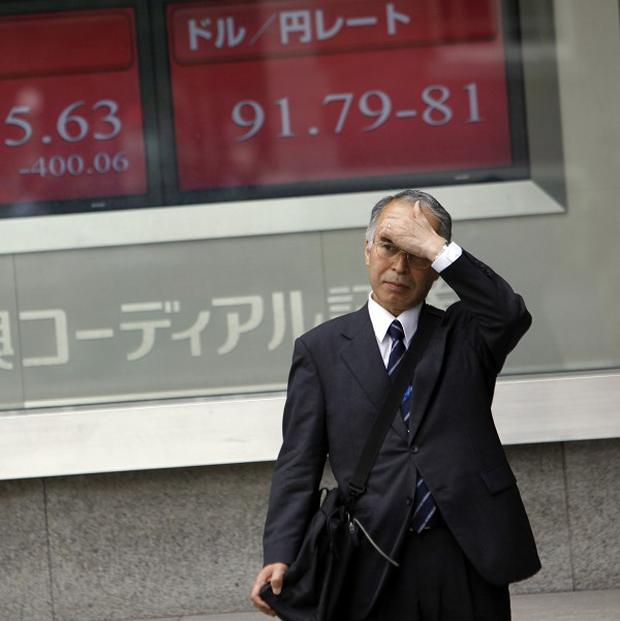 Japan's Nikkei 225 index slid after a ratings downgrade rattled Europe