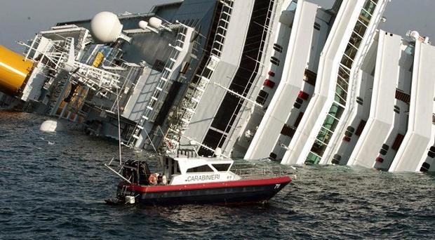 An Irish couple who were on board a stricken cruise ship that ran aground off the Italian coast have spoken of their ordeal (AP)