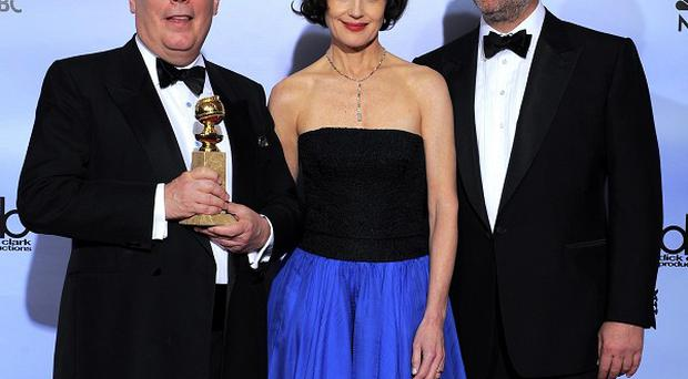 Julian Fellows, Elizabeth McGovern and Hugh Bonneville with the Golden Globe award for Downtown Abbey (AP)