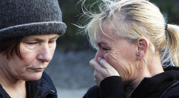 Missing 21-year-old trawlerman Kevin Kershaw's mother Margaret (right) breaks down as she gives an interview