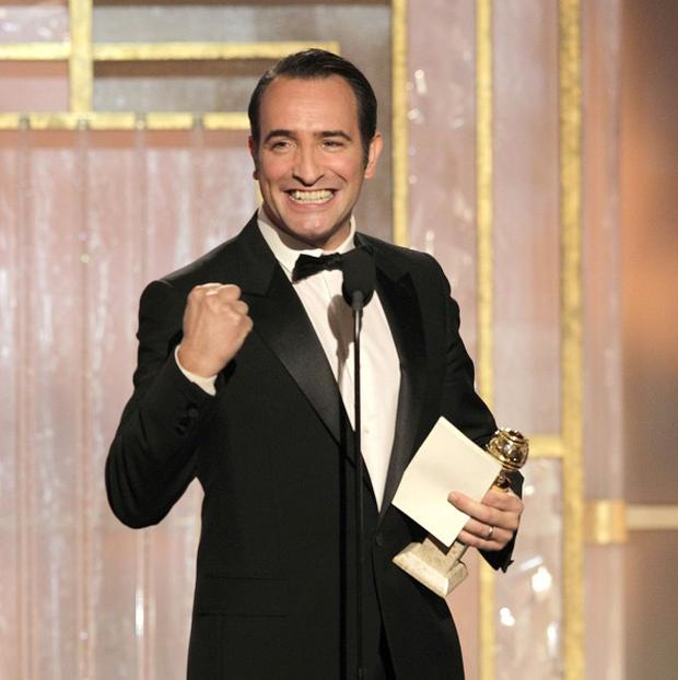 Jean Dujardin accepts the award for Best Performance by an Actor in a Motion Picture for The Artist (AP)
