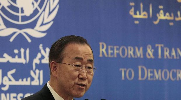 UN Secretary General Ban Ki-moon demands that Syria's president stop killing his own people (AP)