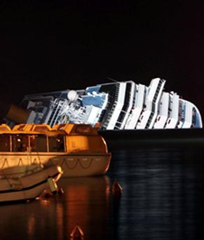 The cruise ship Costa Concordia leans on its side Monday, Jan.16, 2012, after running aground near the tiny Tuscan island of Giglio, Italy, last Friday. The rescue operation was called off mid-afternoon Monday after the Costa Concordia shifted a few inches (centimeters) in rough seas. The fear is that if the ship shifts significantly, some 500,000 gallons of fuel may begin to leak. (AP Photo/Gregorio Borgia)