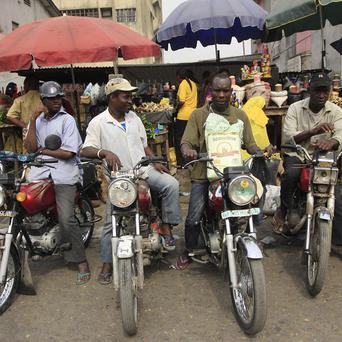 Motorbike taxis wait for passengers at a market in Obalende, Lagos, Nigeria (AP)