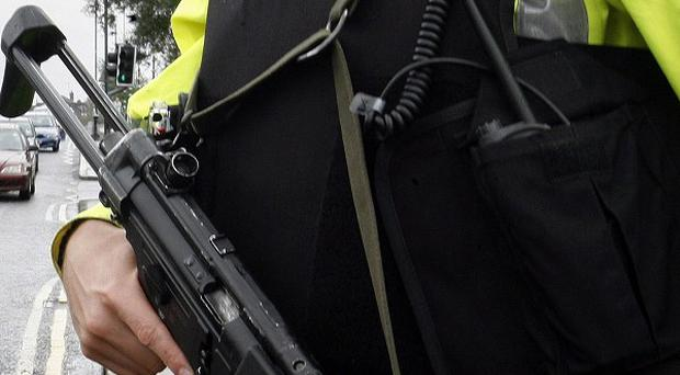 A suspected explosive device was hurled at officers in the Oldpark Road area of Belfast
