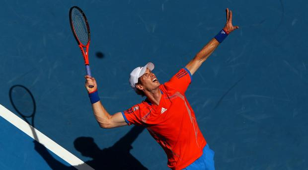Andy Murray serves in his first round match against Ryan Harrison of the USA during day two of the 2012 Australian Open