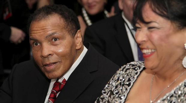 Muhammad Ali , left, celebrates his 70th birthday next to his sister-in-law, Marilyn Williams, at a fund raiser for the Muhammad Ali Center in his hometown of Louisville, Ky., on Saturday, Jan. 14, 2012. Ali turns 70 today.