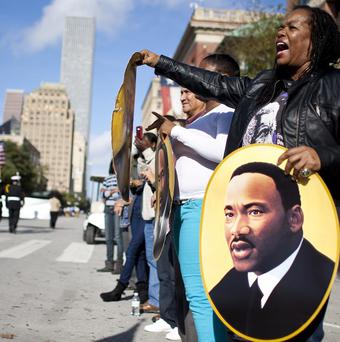 Crowds look on as soldiers take part in a Martin Luther King birthday parade in Houston (AP/Houston Chronicle)