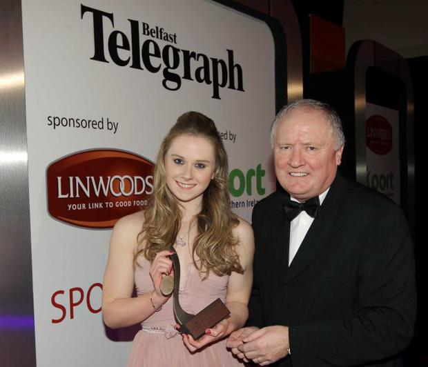 Sycerika McMahon being presented with her Young player of the year award by Eamonn McCartan, CEO of Sport NI. 2011 Linwoods and Sport Northern Ireland Belfast Telegraph Sports Awards at the Ramada Hotel, Belfast.