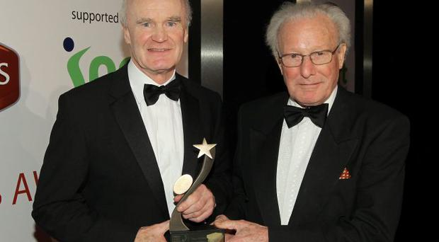 Michael Gibson, left, being presented with his Hall of fame award by Dr Jack Kyle. 2011 Linwoods and Sport Northern Ireland Belfast Telegraph Sports Awards at the Ramada Hotel, Belfast.