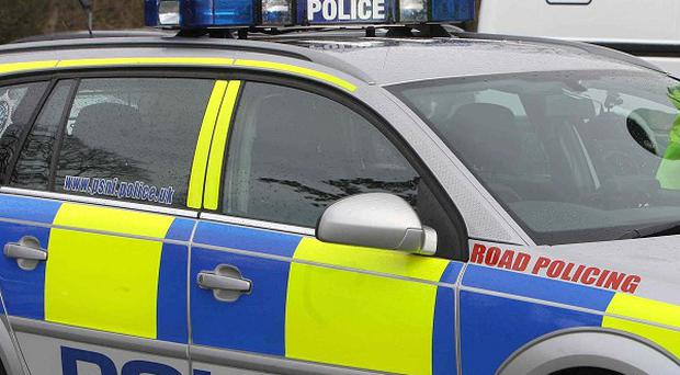An armed robbery occurred at commercial premises in Co Tyrone