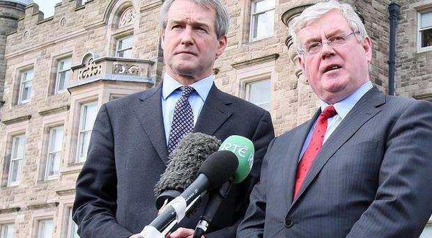 Eamon Gilmore (right) and Northern Ireland Secretary Owen Paterson speak to the media outside Stormont Castle
