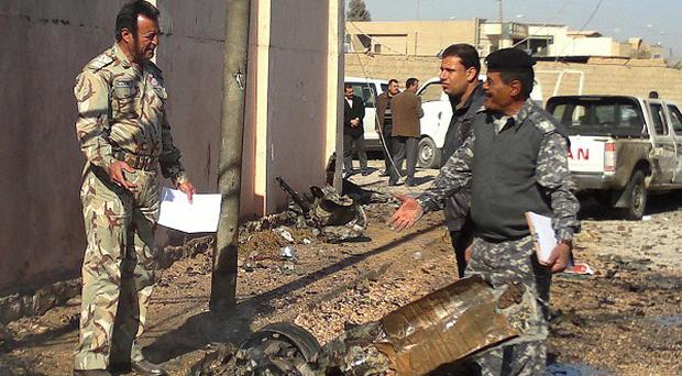 Five Iraqi policemen have been killed in an insurgent attack two days after gunmen stormed a government compound in Ramadi (AP)