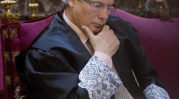 Spanish judge Balthasar Garzon has been put on trial for ordering a wiretap on prisoners (AP)