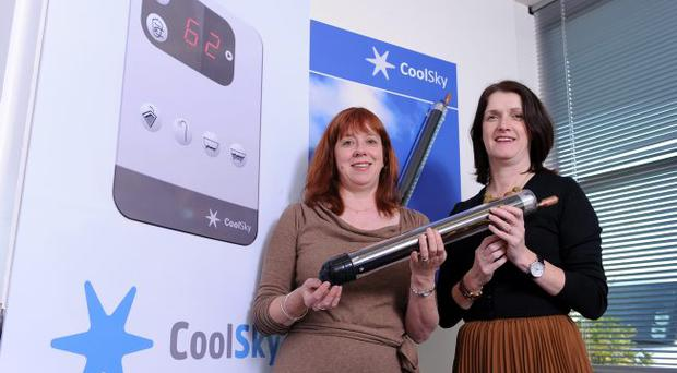 Kathy McVeigh (left), MD of CoolSky, pictured with Invest NI's Olive Hill, at the launch of the new solar heating controller
