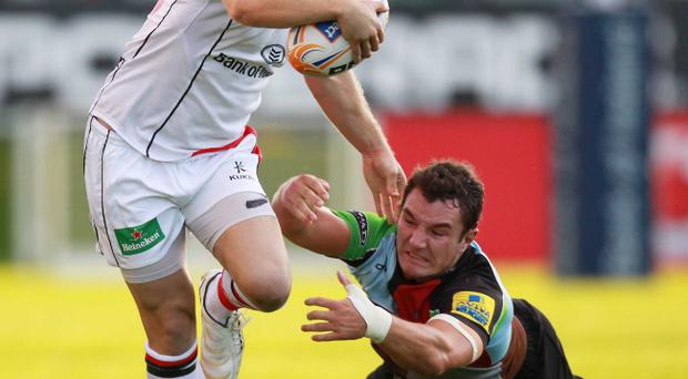 Darren Cave (left) will be missing when Ulster take on Clermont on Saturday with a foot injury that will sideline him for the next six weeks