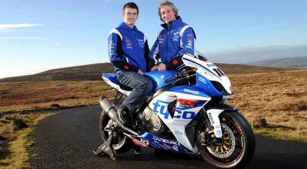 New TAS Suzuki rider Conor Cummions and Tyco team manager Philip Neill