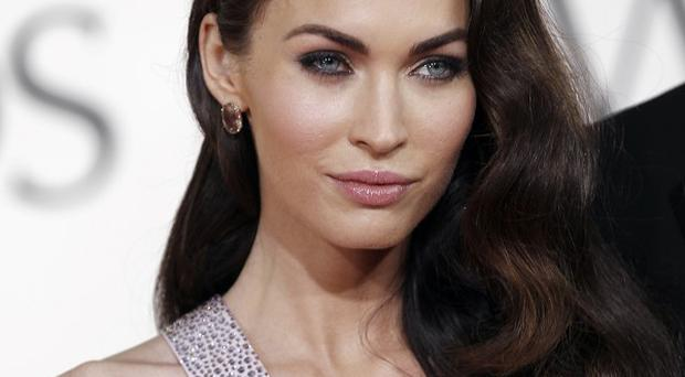 Megan Fox has been in talks about playing Elizabeth Taylor