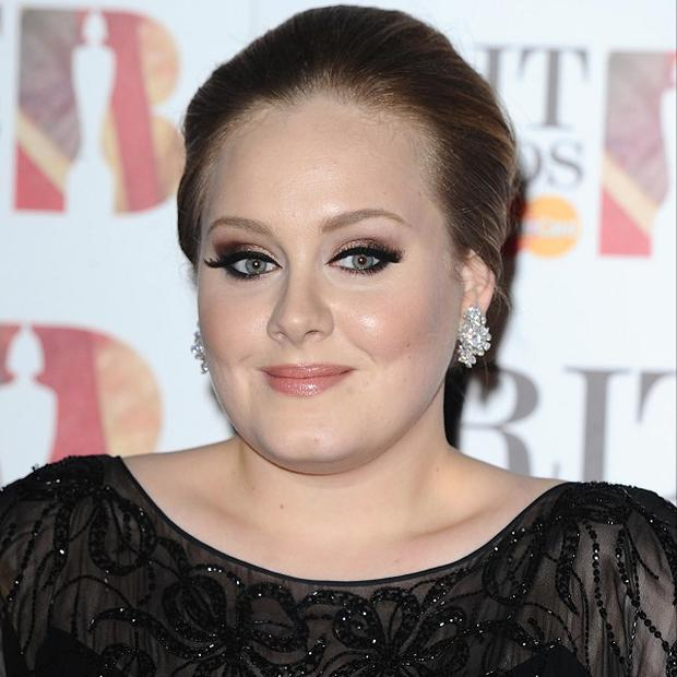 Adele was crowned 2011's karaoke queen by a website
