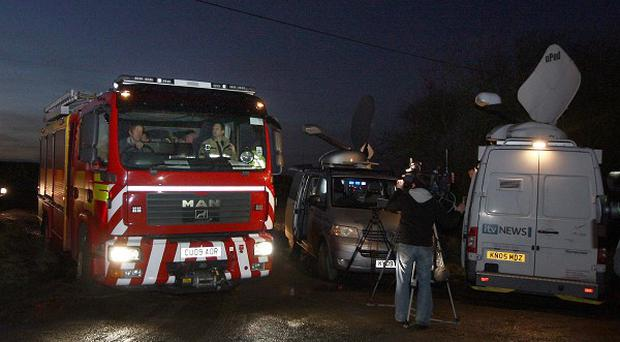 Emergency services and media attend the scene near Long Mountain, near Welshpool, after a light aircraft crash