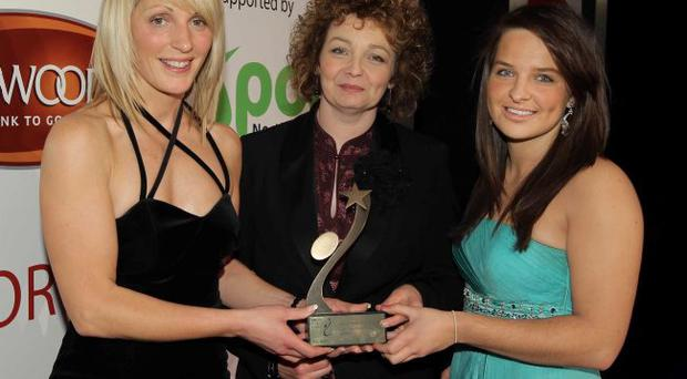Julie Hinds and Natalie Barr from Lurgan College girls hockey being presented with their Young team of the year award by Sports Minister Caral Ni Chuilin . 2011 Linwoods and Sport Northern Ireland Belfast Telegraph Sports Awards at the Ramada Hotel, Belfast.